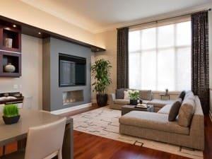 Достоинства электрического камина в интерьере гостиной